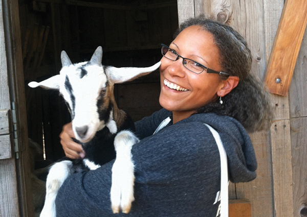 Presenter Lorrie Clevenger with goat on farm